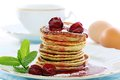 Pancakes with cherry sauce. Royalty Free Stock Image