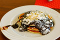 Pancakes with chokolate sirop and sugar powder with almond Royalty Free Stock Photography
