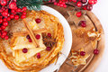 Pancakes with christmas berries and pastry forms Stock Image