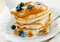 Pancakes closeup of a stack of blueberry with butter and syrup Royalty Free Stock Photo
