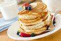 Pancakes closeup of a stack of with butter syrup and fruit Royalty Free Stock Photography