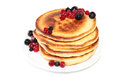 Pancakes with cranberries and black currants (image with clippin Royalty Free Stock Photo