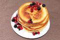 Pancakes with cranberries and black currants Royalty Free Stock Photo