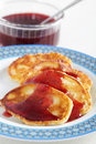 Pancakes with cranberry jam Royalty Free Stock Photography