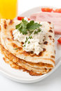 Pancakes with cream cheese and ham crepes thin tomatoes close up Stock Photo