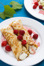 Pancakes with cream and raspberries Stock Photo