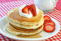Pancakes with cream and strawberries Royalty Free Stock Photography