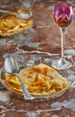Pancakes with Crepe Suzette, in transparent plate with glass of liqueur. French cuisine, step by step recipe Royalty Free Stock Photo