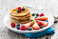 Pancakes fresh with fruits and honey Royalty Free Stock Photos