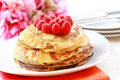 Pancakes with fresh raspberries