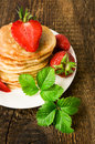 Pancakes with fresh strawberries close up Stock Image