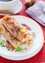 Pancakes with a fruit stuffing and grated chocolate Royalty Free Stock Photos