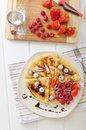 Pancakes with homemade balsamic reduction and fresh fruit strawberries raspberries Stock Photos