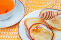 Pancakes with honey and tea Royalty Free Stock Images