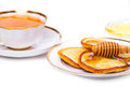 Pancakes with honey and tea Stock Images