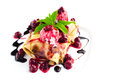 Pancakes with ice cream and cherry toping isolated on white
