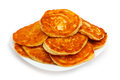 Pancakes many on white plate and on a white background Royalty Free Stock Image