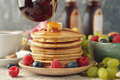 Pancakes with maple syrup and berries Royalty Free Stock Photo