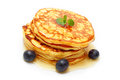 Pancakes with maple syrup and blueberries Royalty Free Stock Image