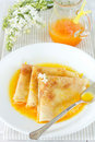 Pancakes with orange sauce Stock Image