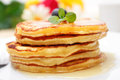 Pancakes pile of with maple syrup peppermint and blueberries Royalty Free Stock Image