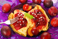 Pancakes with plum confiture Royalty Free Stock Photography
