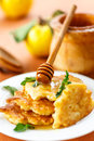 Pancakes with quince on a plate mint Stock Images
