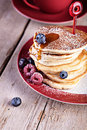 Pancakes with raspberries Stock Photos