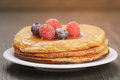 Pancakes with raspberry, blueberry and maple syrup Royalty Free Stock Photo