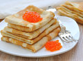 Pancakes with red caviar Stock Photos