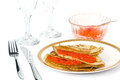 Pancakes with red caviar on a decorated table Royalty Free Stock Images
