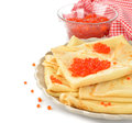 Pancakes with red caviar on a white background Stock Image