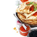 Pancakes with red caviar on white background traditional russian food Stock Image