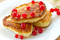 Pancakes with red currants Stock Photos