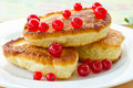 Pancakes with red currants Royalty Free Stock Images