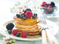 Pancakes stack of with fresh berry and maple syrup selective focus Stock Photography