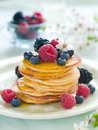 Pancakes stack of with fresh berry and maple syrup selective focus Stock Images