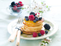 Pancakes stack of with fresh berry and maple syrup selective focus Royalty Free Stock Image