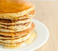 Pancakes stack of with fresh honey Royalty Free Stock Image