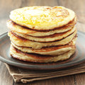 Pancakes stack of on vintage white wooden background Stock Photos