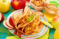 Pancakes with stewed apples ,raisins and honey Royalty Free Stock Photography