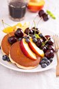 Pancakes with stone fruits Royalty Free Stock Photo
