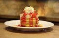 Pancakes with strawberries banana and whip cream Royalty Free Stock Photo