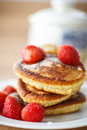 Pancakes with strawberries and powdered sugar on a plate Royalty Free Stock Image