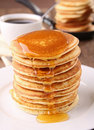 Pancakes and syrup Stock Photos