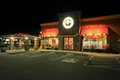 Panda express location at night image of a Stock Images
