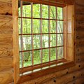 Pane window in a log wall in upper michigan Royalty Free Stock Photography
