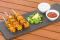 Paneer tikka kebab tandoori indian cheese skewers served on a slate with lemon chili sauce and cucumber and red onion yoghurt Stock Photography