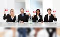 Panel judges holding perfect score signs Royalty Free Stock Photo