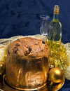 Panettone with wine and Christmas decorations Royalty Free Stock Photography